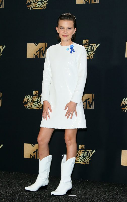Actress Millie Bobby Brown stands in the press room during the 2017 MTV Movie & TV Awards at the Shrine Auditorium in Los Angeles, California, May 7, 2017.  / AFP PHOTO / JEAN-BAPTISTE LACROIX