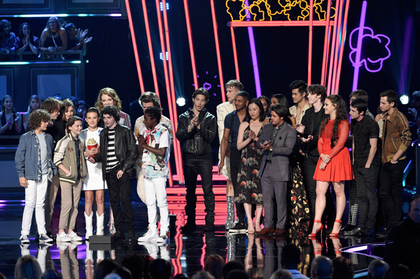LOS ANGELES, CA - MAY 07: (L-R) Actors Gaten Matarazzo, Charlie Heaton, Noah Schnapp, Natalia Dyer, Shannon Purser, Millie Bobby Brown, Finn Wolfhard, Joe Keery, and Caleb McLaughlin accept the award for Show of the Year onstage during the 2017 MTV Movie And TV Awards at The Shrine Auditorium on May 7, 2017 in Los Angeles, California.   Kevork Djansezian/Getty Images/AFP