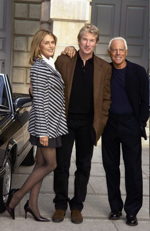 "LONDON - OCTOBER 14:  American actors Richard Gere, Lauren Hutton and Italian designer Giorgio Armani attend the ""Giorgio Armani Retrospective"" at the Royal Academy posing with the Mercedes Benz and Armani clothing used in the film ""American Gigolo"" in which they star on October 14, 2003 in London. (Photo by Dave Benett/Getty Images)"