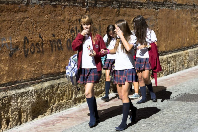 SPAIN - SEPTEMBER 13: Young schoolchildren students strolling in Calle Sacramento in Leon, Castilla y Leon, Spain (Photo by Tim Graham/Getty Images)