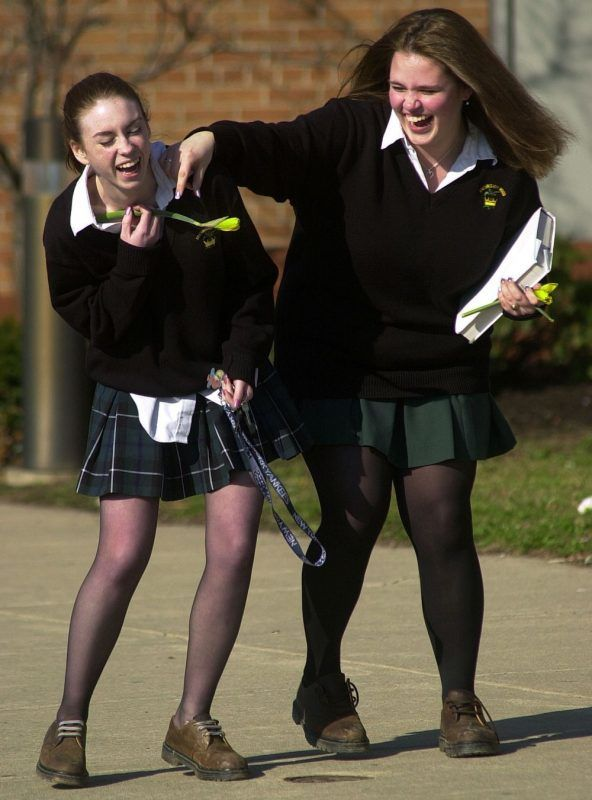 402735 01: Archishop Wood Catholic High Scool students Jessica Jervis (L) and Jessica Pacek (R) laugh at the end of a school day March 21, 2002 in Warminster, PA. In the wake of widespread sex abuse allegations against Catholic priests throughout the country, settlements paid to victims have caused the Catholic Church to sell many of its properties, including parochial schools. (Photo by William Thomas Cain/ Getty Images)