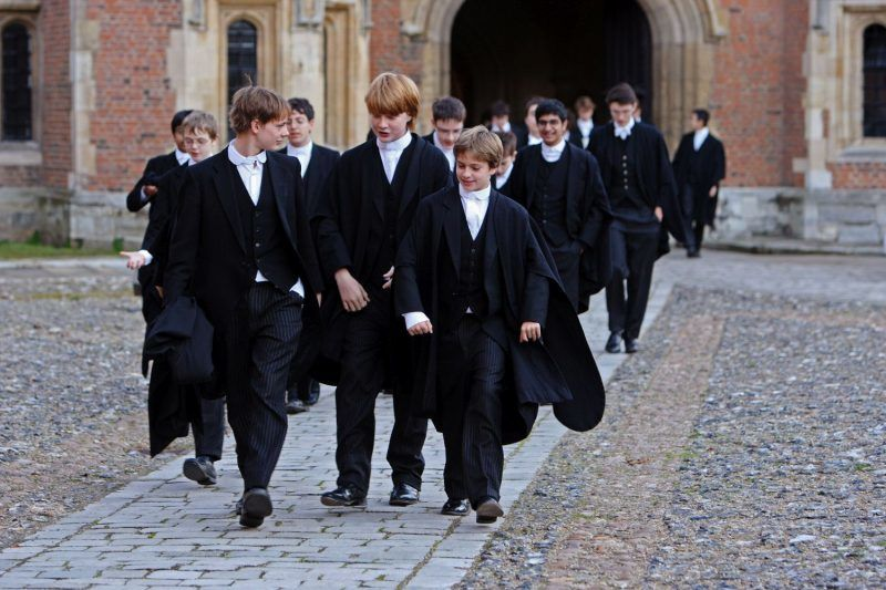 ETON, ENGLAND - MAY 26:  Boys make their way to classes across the historic cobbled School Yard of Eton College on May 26, 2008 in Eton, England. An icon amongst private schools, since its founding in 1440 by King Henry VI, Eton has educated 18 British Prime Ministers, as well as prominent authors, artists and members of royal families from around the world. The school caters for some 1300 pupils divided into 25 houses each one overseen by a housemaster chosen from the senior ranks of the staff which number around 160.  (Photo by Christopher Furlong/Getty Images)