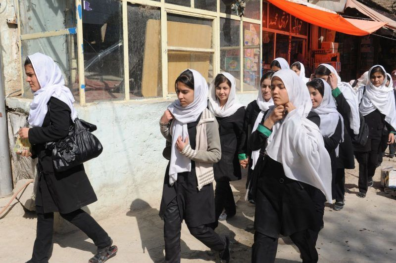 KABUL, AFGHANISTAN - OCTOBER 16: A group of young girls in veil and uniform on their way to school in Shahr-e Now neighborhood on October 16, 2011 in Kabul, Afghanistan. (Photo by Kaveh Kazemi/Getty Images)