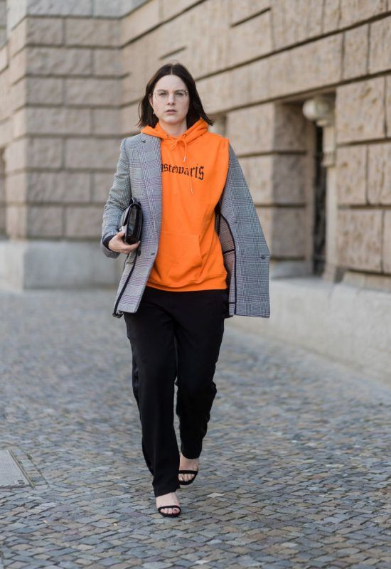 BERLIN, GERMANY - AUGUST 17: Maria Barteczko wearing orange hoodie Wasted Paris, oversized checked blazer in grey Stella McCartney, wide leg black trousers H&M, black heels Gianvito Rossi, black python printed bag Jimmy Choo, round glasses Ray Ban on August 17, 2017 in Berlin, Germany. (Photo by Christian Vierig/Getty Images)