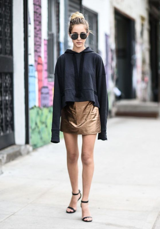 NEW YORK, NY - MAY 11:  Fashion Blogger Rosa Crespo is seen in Noho wearing a Nude jumper, Matel gold skirt, YSL heels and Quay sunglasses on May 11, 2017 in New York City.  (Photo by Daniel Zuchnik/Getty Images)