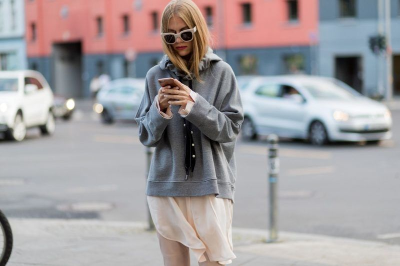 BERLIN, GERMANY - JULY 06: A guest wearing a grey hoody during the Mercedes-Benz Fashion Week Berlin Spring/Summer 2018 at Kaufhaus Jandorf on July 6, 2017 in Berlin, Germany. (Photo by Christian Vierig/Getty Images)