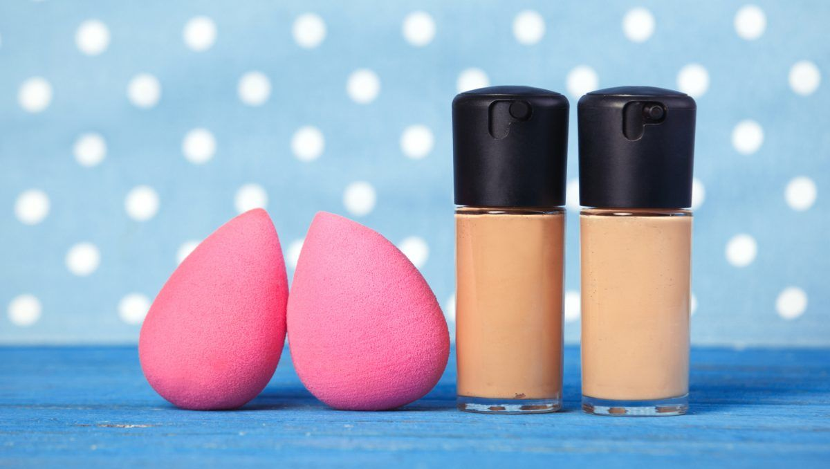 Beauty blender on blue background.