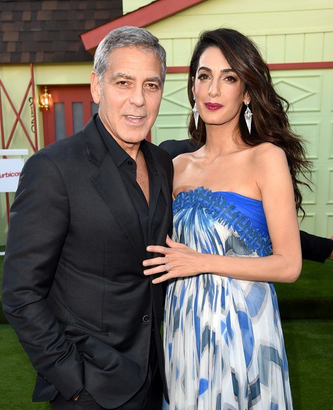 """LOS ANGELES, CA - OCTOBER 22:  Executive producer/director George Clooney and his wife Amal Clooney arrive at the premiere of Paramount Pictures' """"Suburbicon"""" at the Village Theatre on October 22, 2017 in Los Angeles, California.  (Photo by Kevin Winter/Getty Images)"""