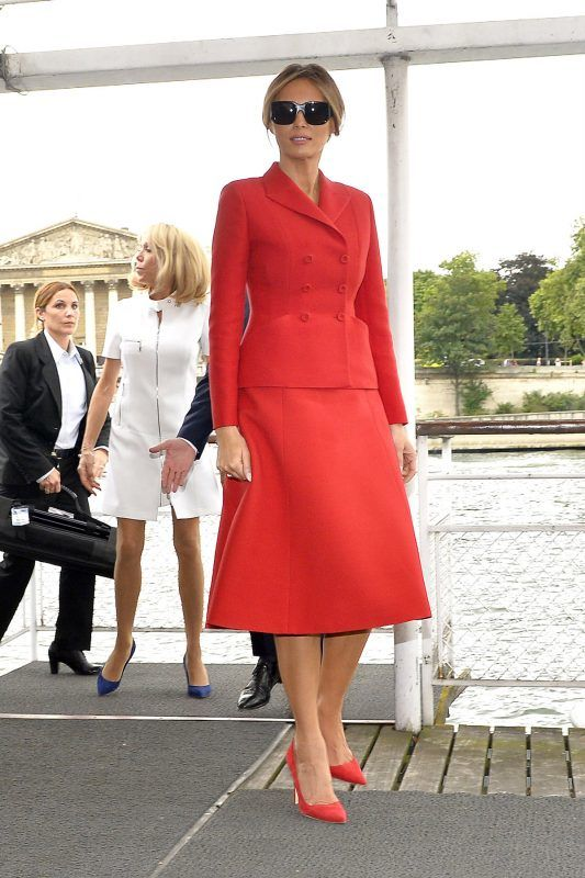 PARIS, FRANCE - JULY 13:  (L-R) United States First Lady Melania Trump and French First Lady Brigitte Macron leave the dock after a boat ride on the Seine river on July 13, 2017 in Paris, France. The United States of America President Donald Trump and his wife are on a 2 day visit to Paris.  (Photo by Aurelien Meunier/Getty Images)