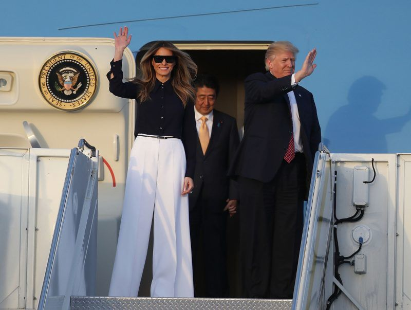 WEST PALM BEACH, FL - FEBRUARY 10:  President Donald Trump and his wife Melania Trump arrive with Japanese Prime Minister Shinzo Abe on Air Force One at the Palm Beach International Airport as they prepare to spend part of the weekend together at Mar-a-Lago resort on February 10, 2017 in West Palm Beach, Florida. The two are scheduled to get in a game of golf as well as discuss trade issues.  (Photo by Joe Raedle/Getty Images)