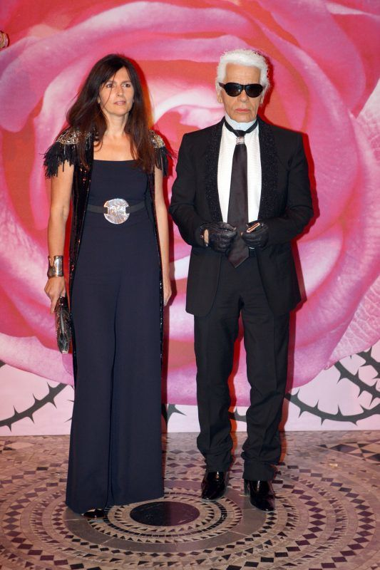 "Designer Karl Lagerfeld (R) arrives with Virginie Viard, French director of Chanel's creation studio, for the annual Rose Ball ""Movida"" at the Monte-Carlo Sporting Club in Monaco, March 29, 2008. The Rose Ball is one of the major charity events in Monaco. Created in 1954, it benefits the Princess Grace Foundation. AFP PHOTO  VALERY HACHE / AFP PHOTO / VALERY HACHE"
