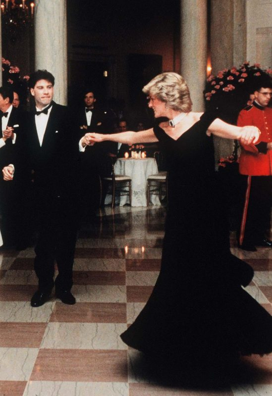 File Photo: Princess Diana on her visit to America and wearing an evening dress designed by Victor Edelstein, dances with movie star John Travolta in the White House on November 9, 1985. (Photo by © Pool Photograph/Corbis/Corbis via Getty Images)