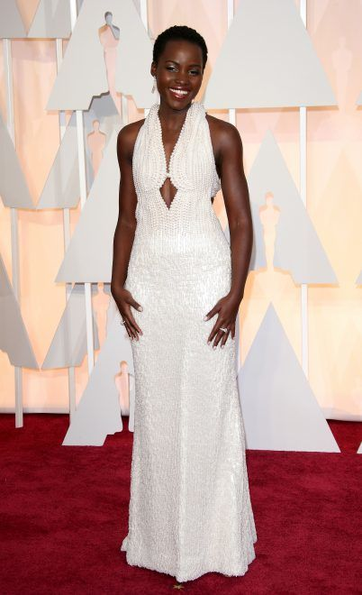 HOLLYWOOD, CA - FEBRUARY 22: Lupita Nyong'o arrives at the 87th Annual Academy Awards at Hollywood & Highland Center on February 22, 2015 in Los Angeles, California. (Photo by Dan MacMedan/WireImage)